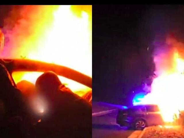 Impressionnant sauvetage par deux policiers d'un homme coincé dans sa voiture en flammes (VIDEO)