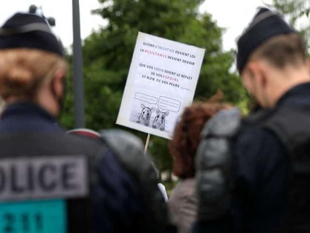 Coronavirus dans le monde: inquiétude en Chine et manifestations en France
