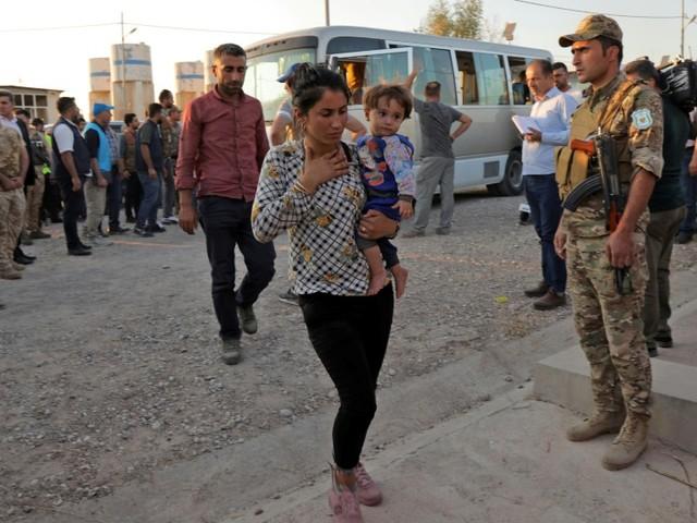 """En Irak, des Kurdes syriens trouvent refuge loin du """"sang"""" et des """"roquettes"""""""