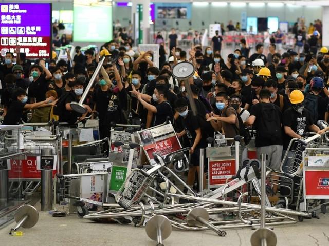 Hong Kong: Trump critiqué pour son apparente bienveillance à l'égard de Pékin