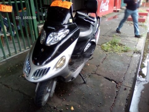 Vendo moto scutler en 450 dlrs