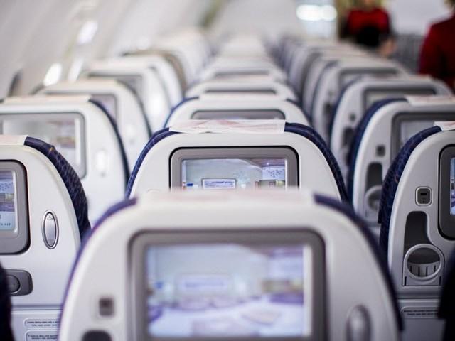 Um desabafo sobre tablets nas poltronas dos aviões - ou, como é possível não ter déficit de atenção?