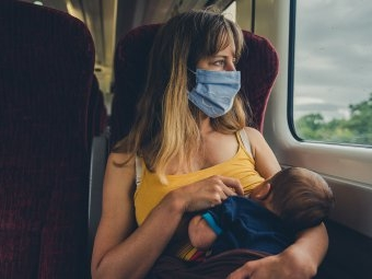 WHO empfiehlt Stillen mit Maske