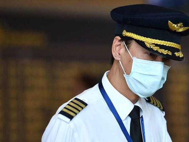 Schutz vor Coronavirus: Sollten Flug-Passagiere eine Mundschutzmaske tragen?