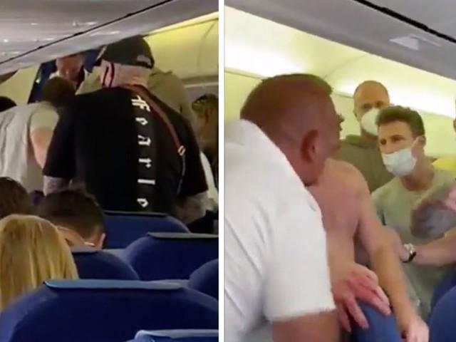 Handyvideo: Mundschutz-Streit in Flugzeug eskaliert: Maskenverweigerer entfachen Schlägerei