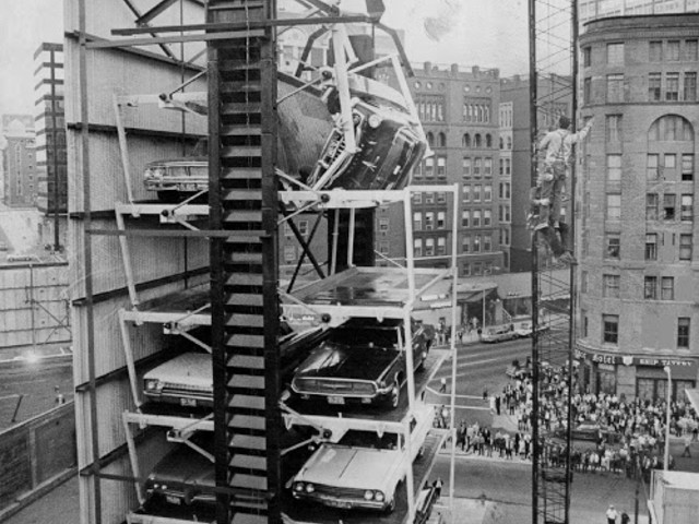 A car teeters at the top of a paternoster parking elevator as a result of a broken bolt in Denver, Colorado.1970
