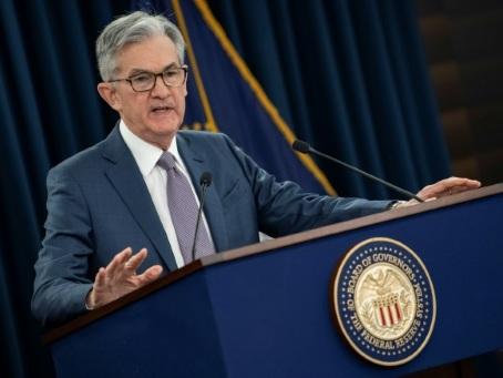 La Banque centrale américaine maintient ses taux à zéro, voit un rebond de l'économie en 2021