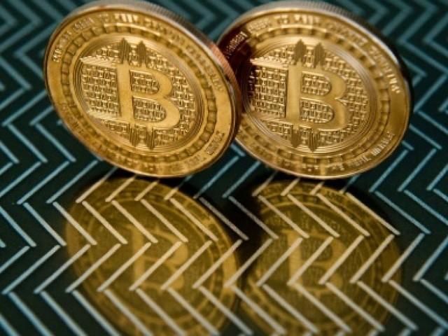 Le bitcoin dépasse le seuil de 14.000 dollars