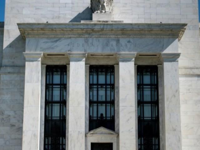 La Fed relève ses taux, ses prévisions de croissance et d'inflation
