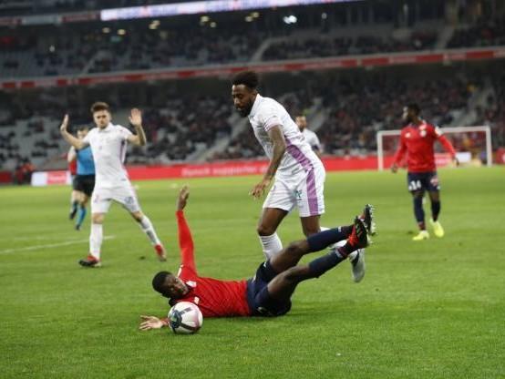Foot - L1 - Lille, dauphin du PSG, arrache le nul à domicile contre Reims