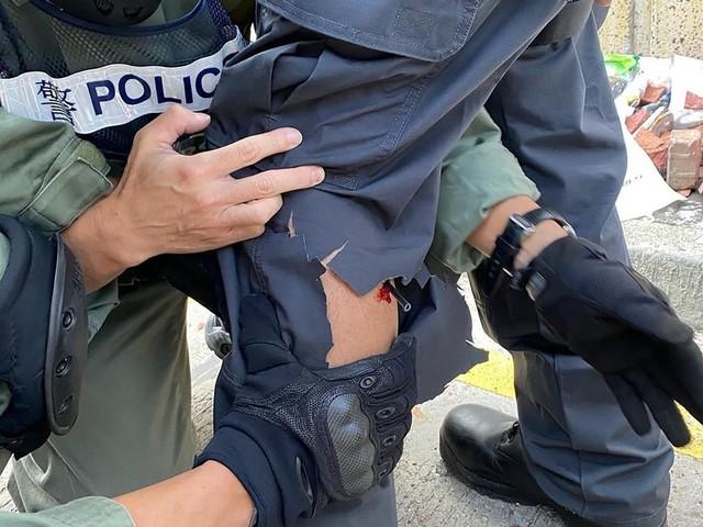 À Hong Kong, un policier blessé par une flèche tirée par un manifestant