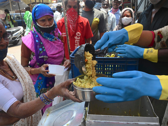 Virus: record de contaminations en Inde, les JO à nouveau en question