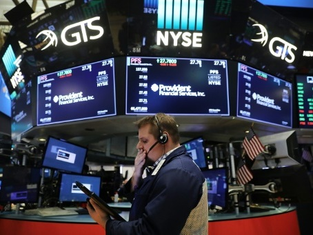 Wall Street en ordre dispersé, les résultats d'IBM et d'AmEx pèsent