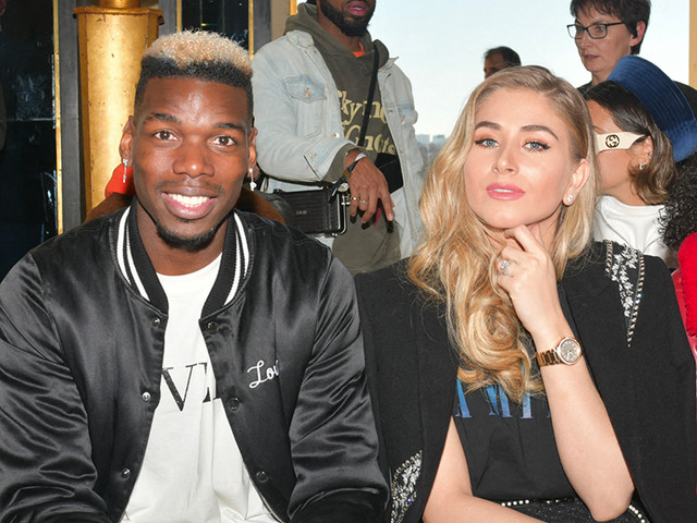 Paul Pogba en béquilles avec sa femme, Maria, pour assister à la Fashion Week de Paris