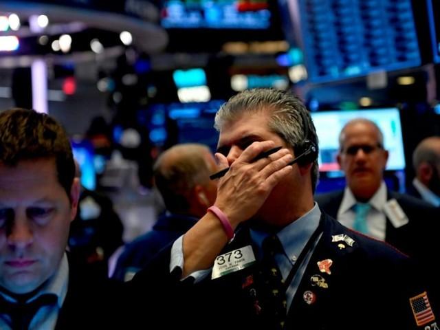 Wall Street dans le rouge, plombée par des résultats jugés décevants
