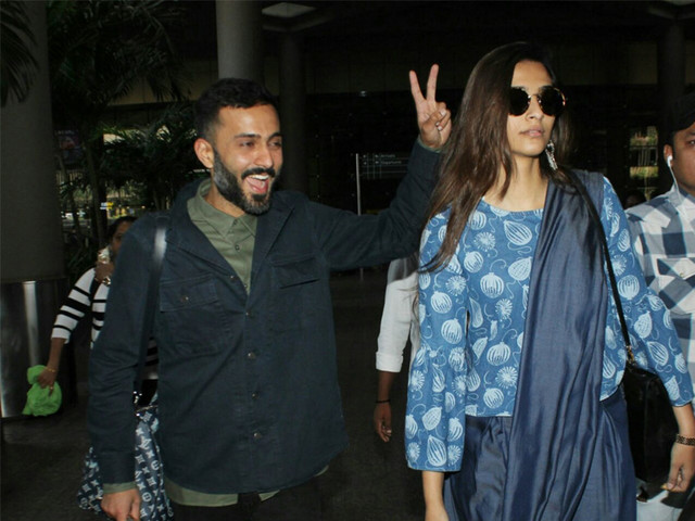 Pic: Anand Ahuja gets goofy at the airport with Sonam Kapoor