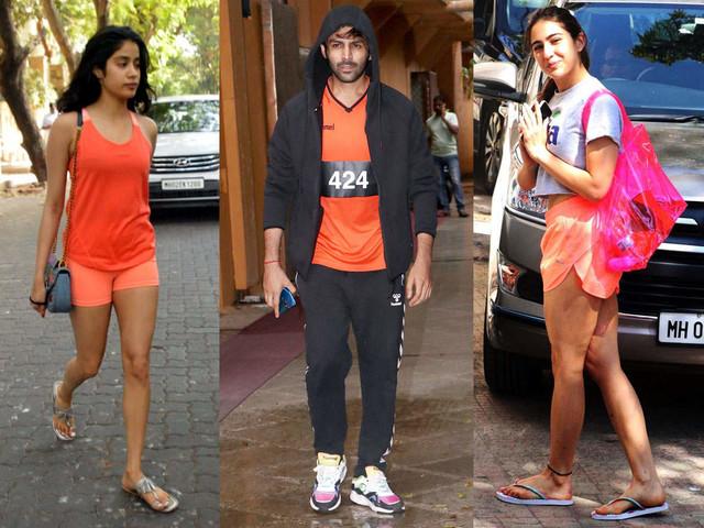 Sara, Janhvi and Kartik sport orange gym wear
