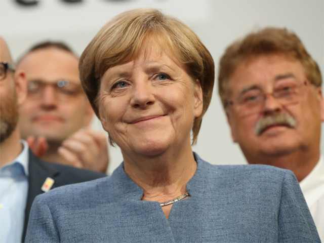Vote winner Angela Merkel faces tricky coalition talks, hard-right 'earthquake'