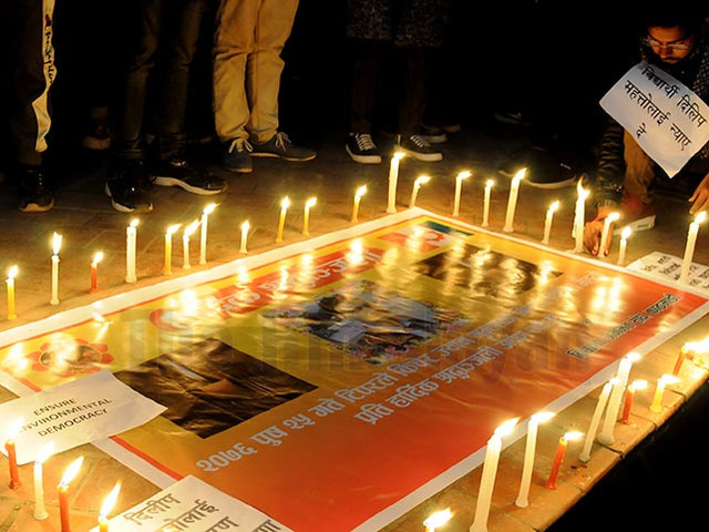Candle light vigil held in support of Mahato