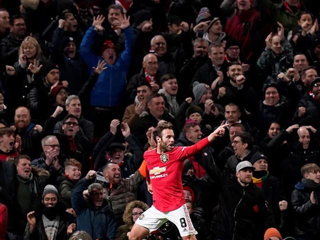 Mata's cool finish sends Man United through
