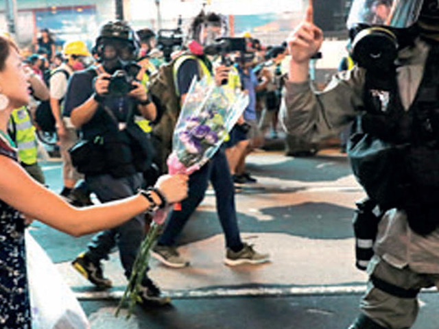 Hong Kong police fire tear gas and water canon as protesters defy ban