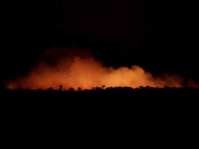 As Amazon burns, Brazil's Bolsonaro tells rest of world not to interfere