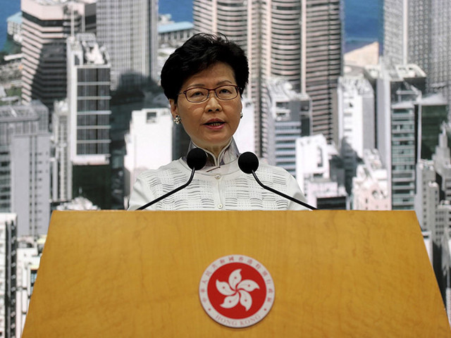 Hong Kong leader suspends extradition bill, says sorry