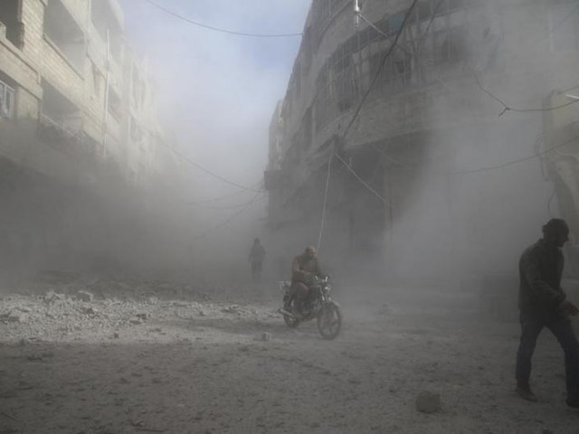 Syrian, Russian jets bomb residential areas in eastern Ghouta: witnesses, monitor