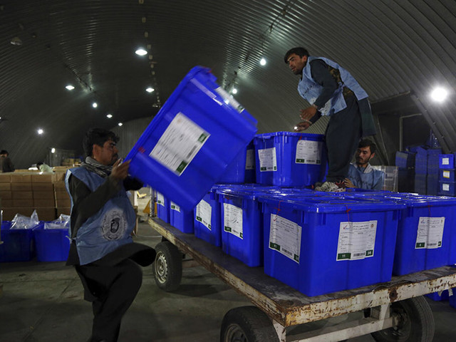 The Latest: Taliban claim attacks on Ghani rally, in Kabul