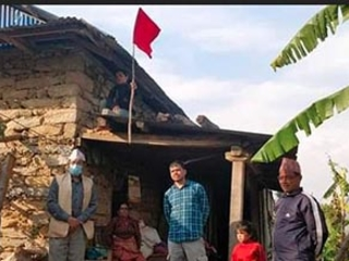 Red flag placed on housetops to identify people coming from abroad in Dolakha