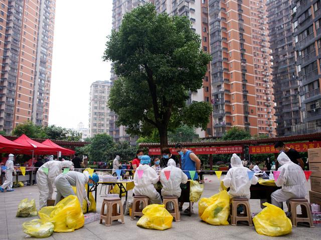 Crowds at Wuhan clinics fear coronavirus testing could rekindle disease