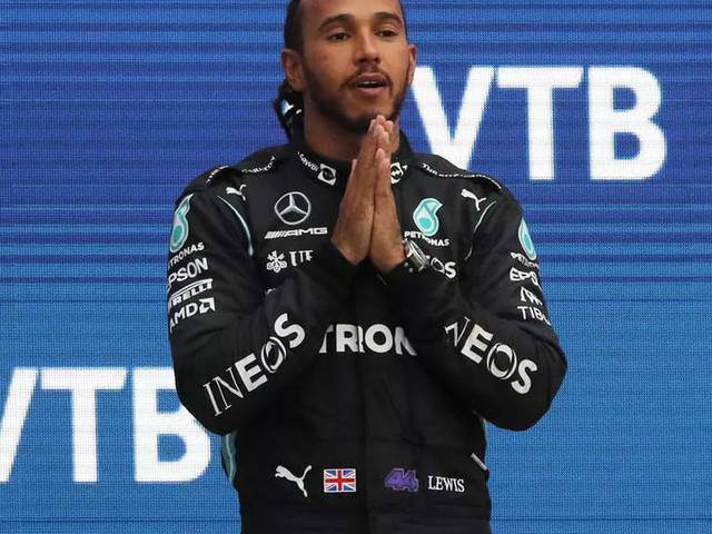 Hamilton wins 100th F1 race to take lead over Verstappen