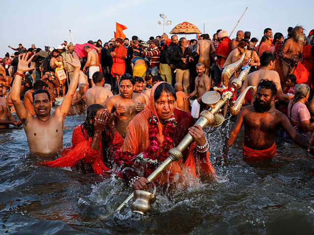 Hindu ascetics lead millions of Indians in holy bath