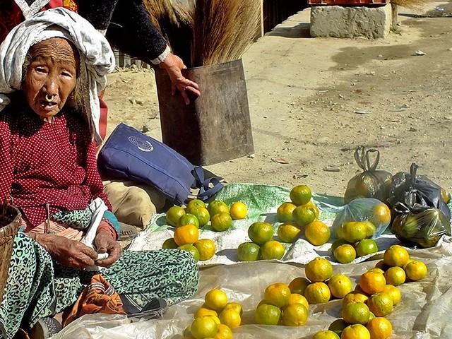 Grandma selling oranges