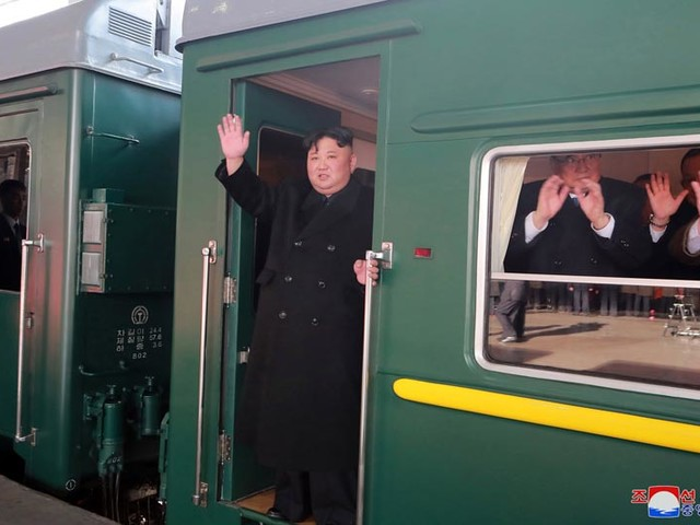 North Korea leader Kim Jong Un boards train to summit
