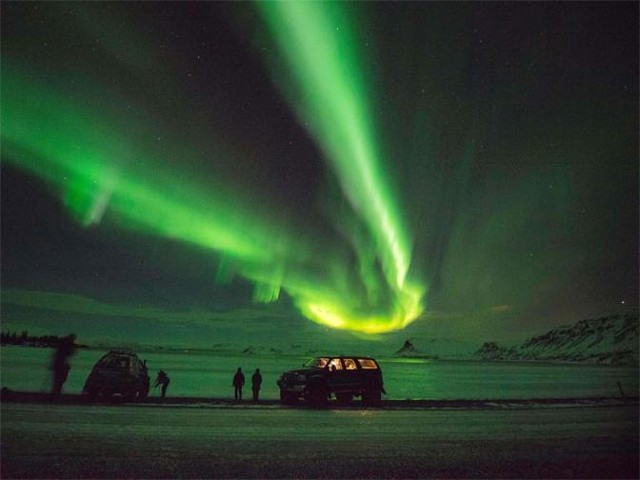 Soak in the bright-hued skies as you witness once-in-a-lifetime phenomena in Svalbard