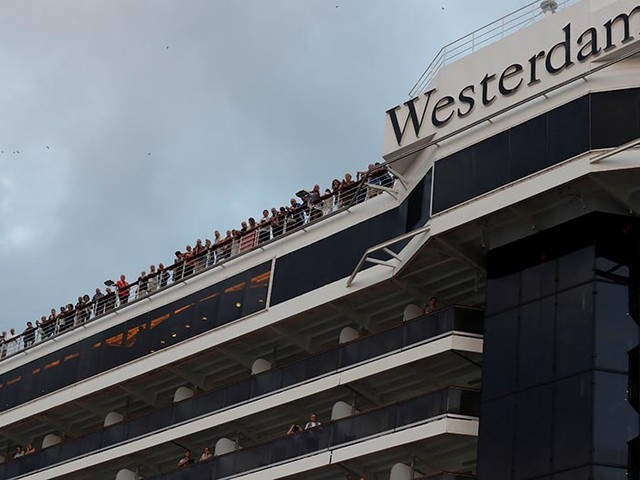 US flies 338 Americans home from cruise ship, including 14 with coronavirus