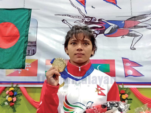 Dhami bags historic gold in wrestling