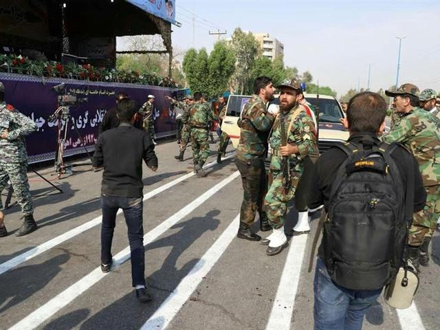 Gunmen kill 24, including 12 Revolutionary Guards, in attack on Iran military parade