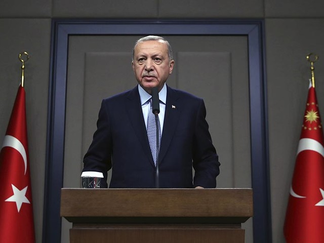 Erdogan warns Kurdish fighters to pull out of Syrian region