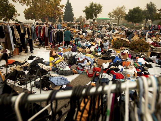 Fire refugees camp in Walmart parking lot amid uncertainty