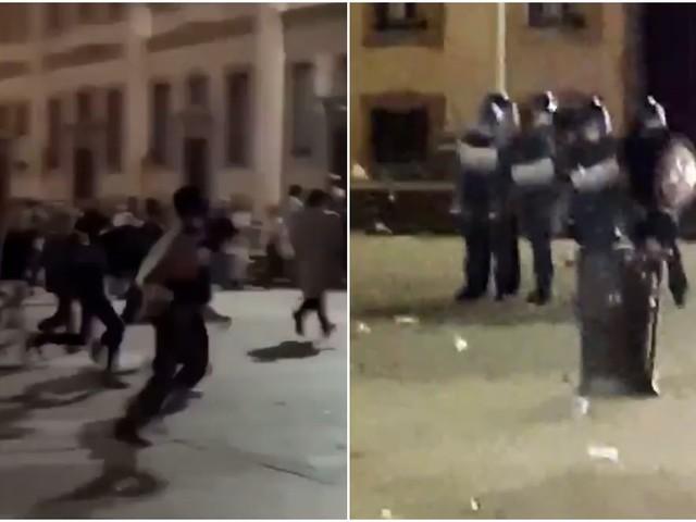 Milano, in centinaia violano il coprifuoco. Maxi rissa in zona Porta Ticinese: lanci di bottiglie contro la polizia (Video)