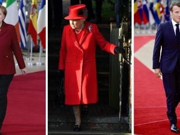 Le giacche di Angela Merkel, gli abiti di Elisabetta II e i completi blu maschili: ecco i simboli del potere