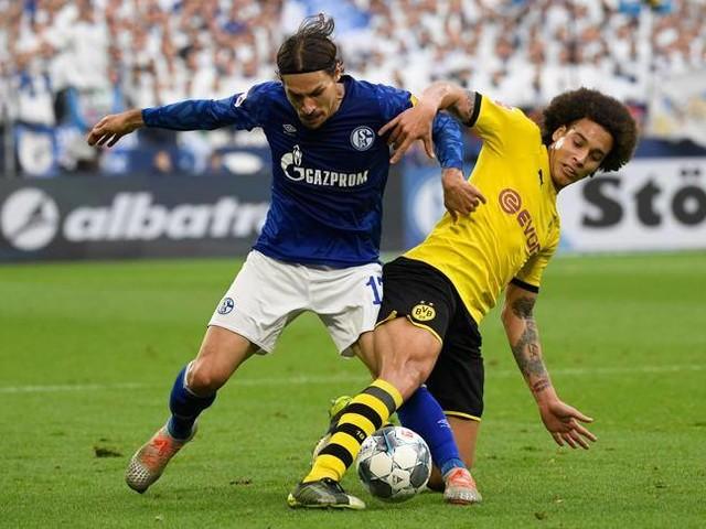 La Bundesliga riparte: le sagome di cartone sugli spalti, lo psicologo, le paure. È un test per tutta Europa