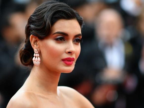 Labbra rosse e «cat eye» protagonisti sul red carpet di Cannes