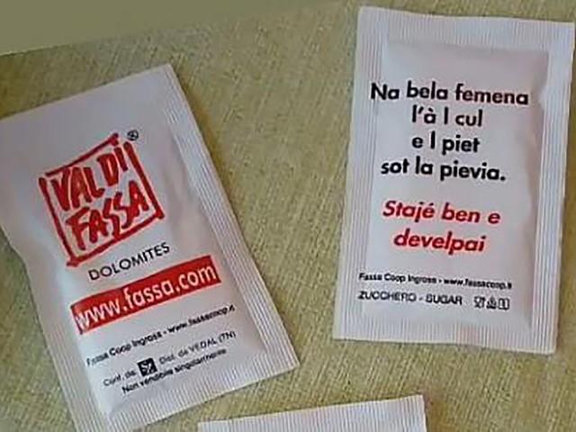 Polemica sul proverbio ladino sulle donne belle se formose stampato sulle bustine di zucchero