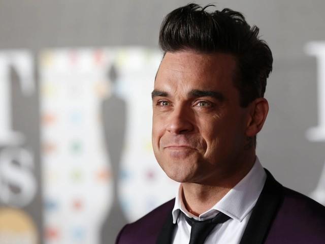 """Robbie Williams: """"Ammiro Liam Gallagher, ma ho ancora voglia di pestarlo"""""""