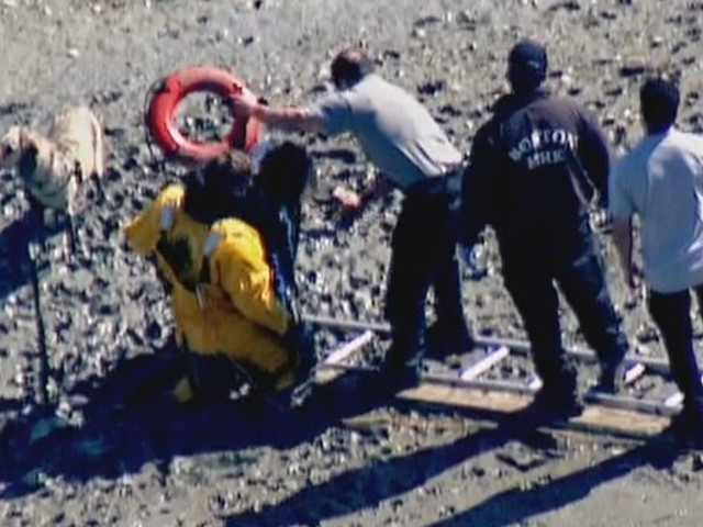 Firefighters Rescue Woman And Dog Stuck In Mud In East Boston