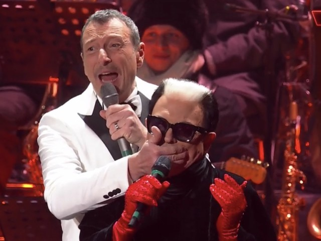 Cristiano Malgioglio vuole spoilerare Sanremo, Amadeus gli tappa la bocca