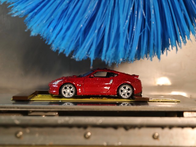 Nissan uses a miniature car wash to make sure your paint lasts